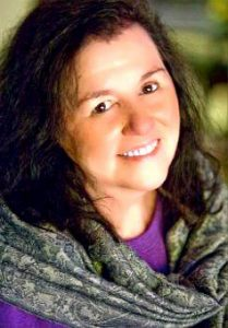 Spiritual Psychic Medium Cynthia Becker bright inviting eyes beautiful smile long dark hair
