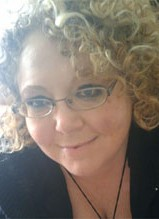 Lana Johnson Psychic Dallas Cute curly blond hair, nice smile, pretty complexion and feminine glasses
