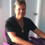 psychic chicago psychic reading andrew anderson chicago psychic medium at his purple desk with tarot cards and crystal ball